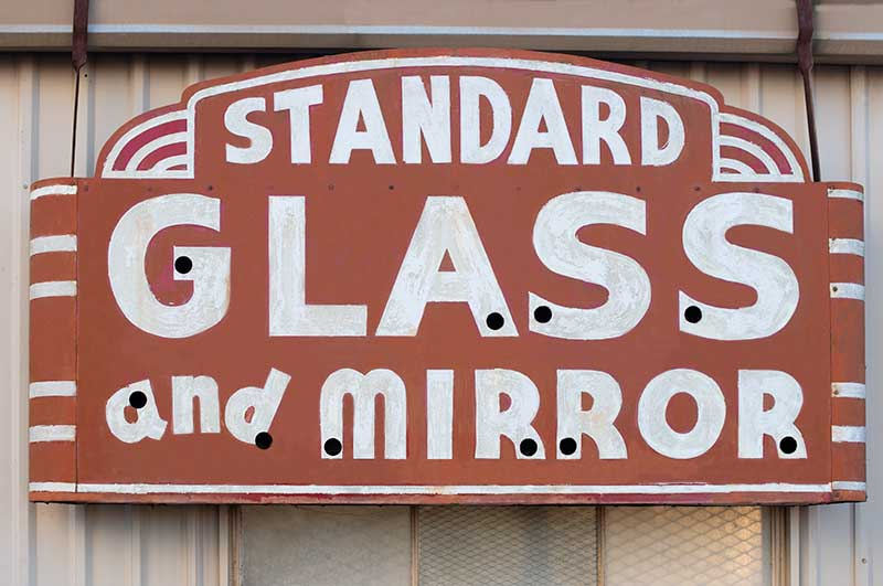 Vintage outdoor signage for Standard Glass and Mirror.